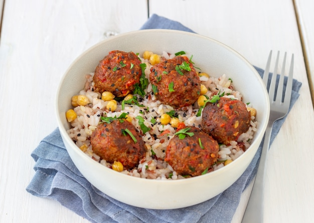 Meatballs with rice, chickpea and sesame seeds. healthy eating. diet. oriental cuisine. Premium Photo