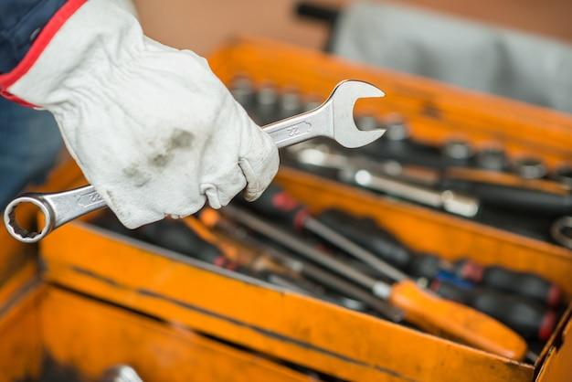 Mechanic hand holding a wrench Premium Photo