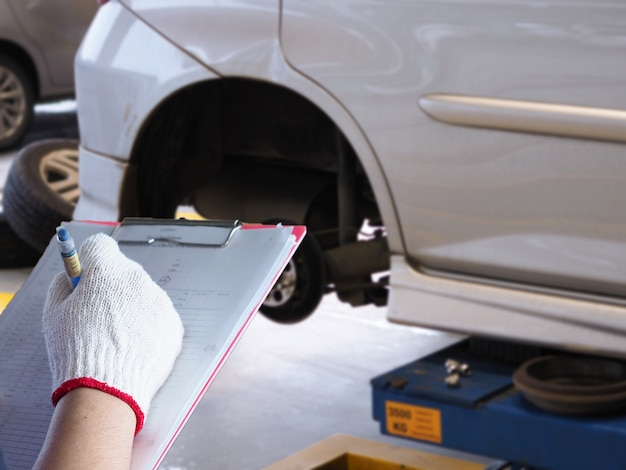 The mechanic is checking the car. Premium Photo