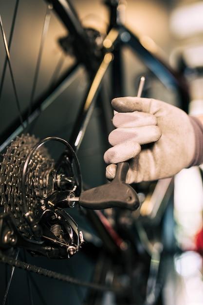 Mechanic repairing a bicycle Free Photo