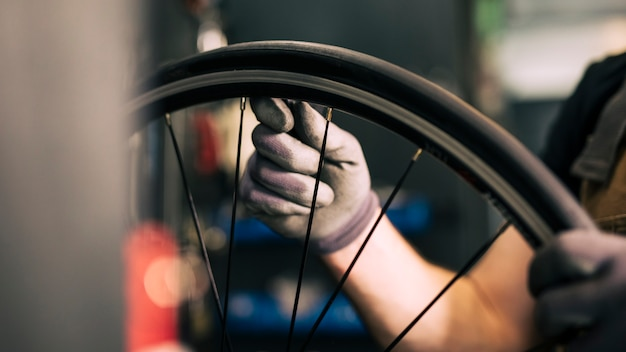 Mechanic repairing a bicycle Free Photo