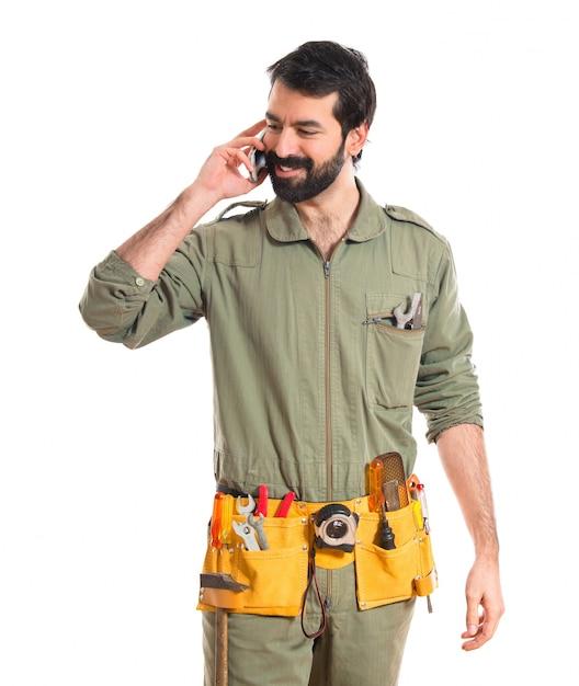 Mechanic Talking To Mobile Photo