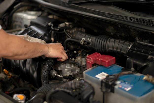 Mechanic working car maintenance Premium Photo