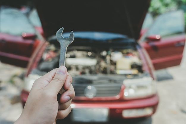 Mechanical engineer hands open the car skirt to check the oil level of the car. Premium Photo