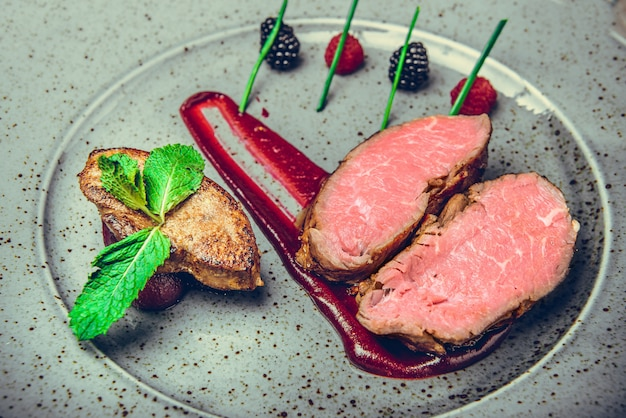 Medallions of veal, with sauce on a plate. Premium Photo