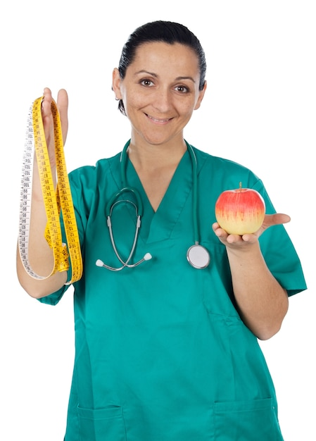 Medial staff with an apple and tape measure Premium Photo