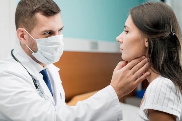 Medic providing throat examine Free Photo