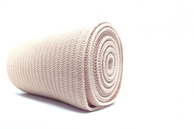 Medical elastic bandage roll for support first aid kit isolated on white. Premium Photo
