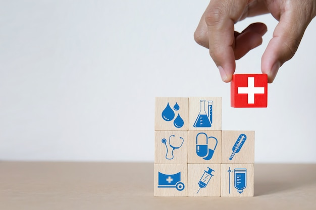 Medical and health graphics icons on wooden blocks. Premium Photo
