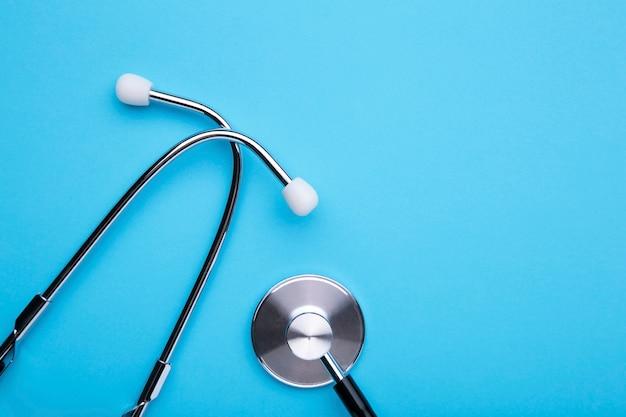 Medical stethoscope on blue Premium Photo