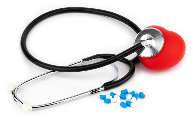 Medical,  stethoscope pills and heart on a white. Premium Photo