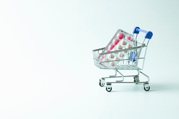 Medicine blister in trolly cart isolated on white background Premium Photo