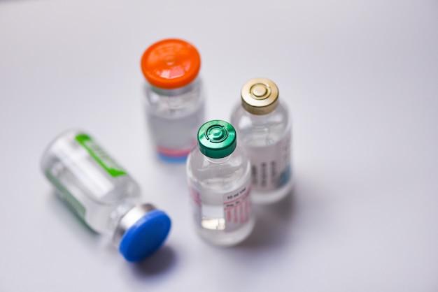 Medicine bottles glass for syringe injection needle medication drug bottle equipment medical tool Premium Photo