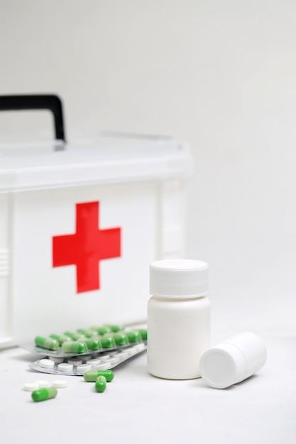 Medicine bottles and home medical kit Free Photo