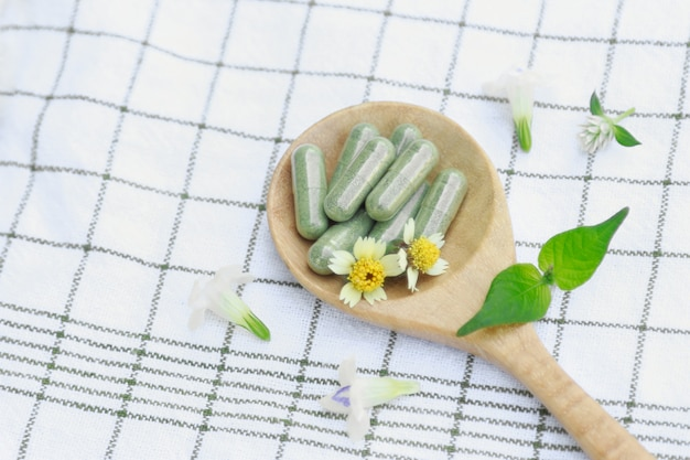Medicine capsules from organic herb for healthy eating Premium Photo
