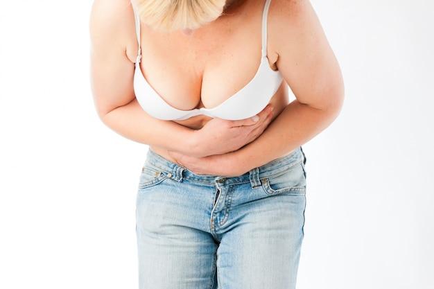 Medicine and disease - stomach pain or abdominal cramps Premium Photo