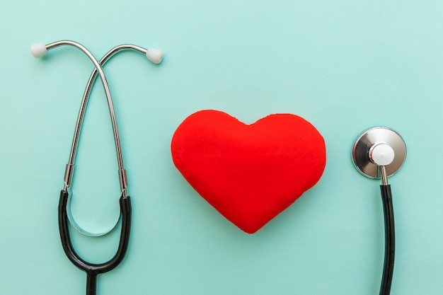 Medicine equipment stethoscope and red heart isolated on trendy pastel blue Premium Photo
