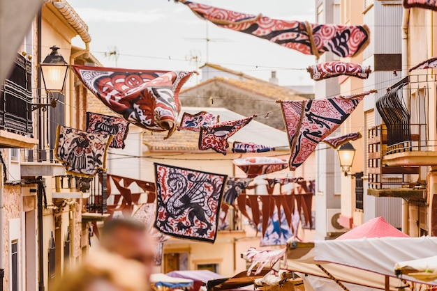 Medieval banners hanging between streets at an open-air festival. Premium Photo
