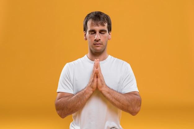 Meditating man medium shot Free Photo