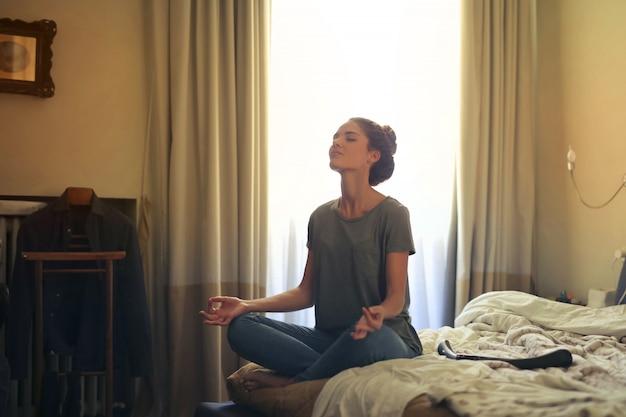 Meditation at home Premium Photo