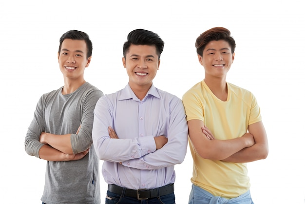 Medium closeup of three asian friends standing arms folded Free Photo