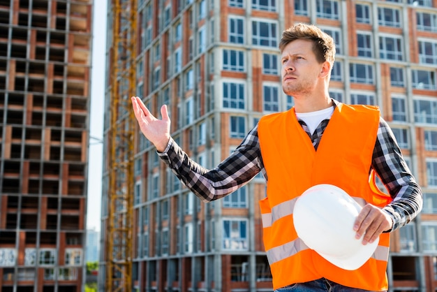 Medium shot of angry construction worker Free Photo