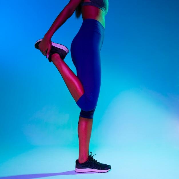 Medium shot of athlete stretching Free Photo