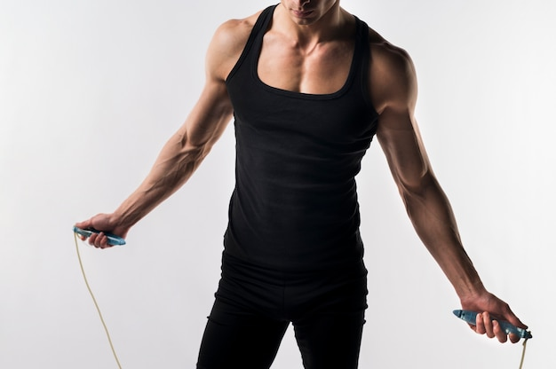 Medium shot of athletic man with jumping rope Free Photo