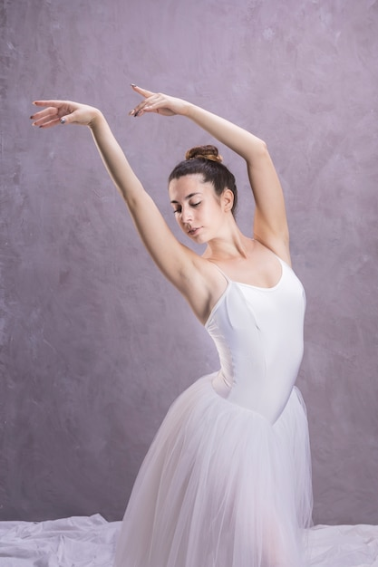 Medium shot ballerina with arms floating Free Photo