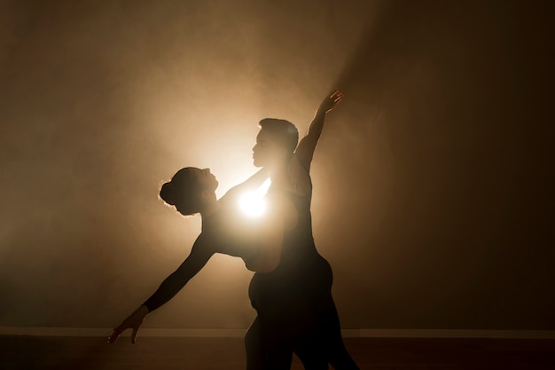 Medium shot ballet dancers couple Free Photo
