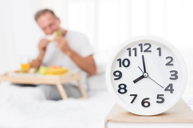 Medium shot blurred man having breakfast in the morning Premium Photo