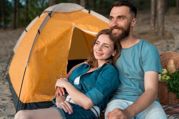 Medium shot camping couple looking away Free Photo