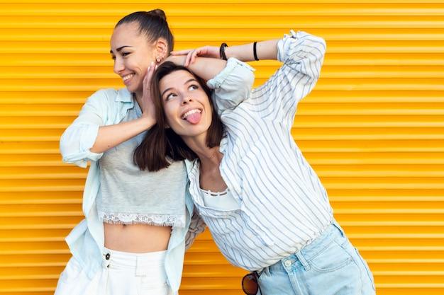 Medium shot charming friends being silly Premium Photo