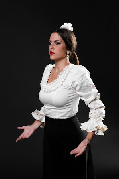Medium shot confident flamenca dancer Free Photo