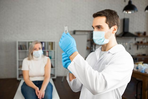 Medium shot doctor preparing vaccine Free Photo