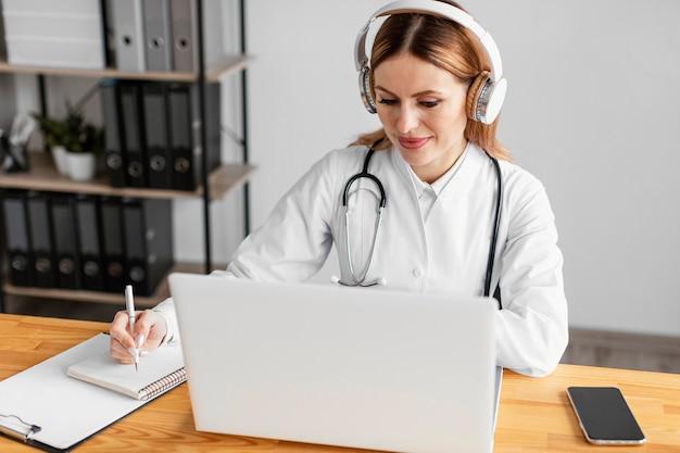 Medium shot doctor with headphones Free Photo