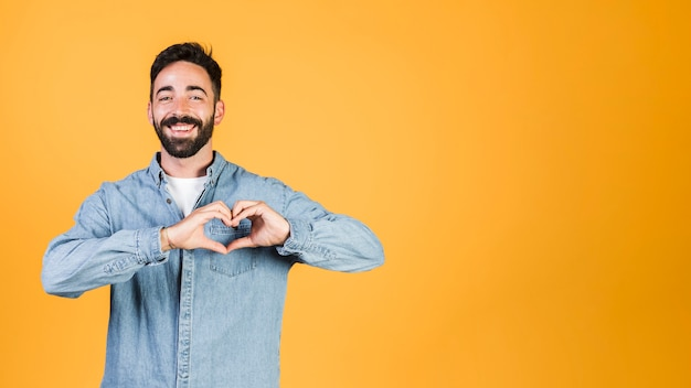Medium shot doing heart sign gesture Free Photo