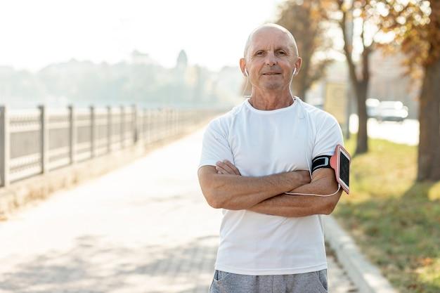 Medium shot elder runner outdoors Free Photo