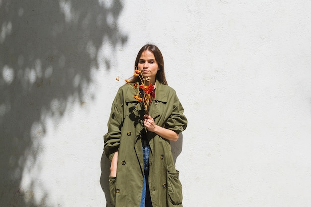 Medium shot fashion woman holding a bunch of peppers Free Photo