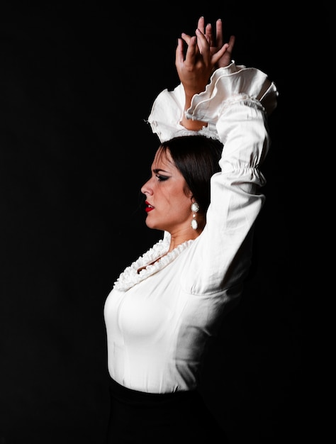 Medium shot flamenca looking away Free Photo
