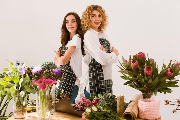 Medium shot florists posing together Free Photo