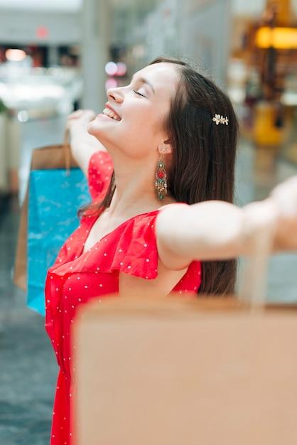 Medium shot girl having fun at shopping mall Free Photo