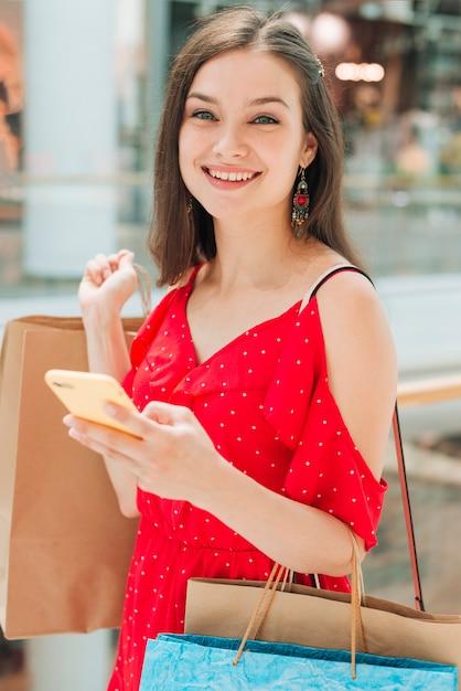 Medium shot girl smiling at camera Free Photo