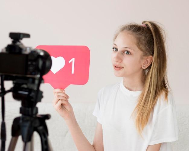 Medium shot girl with video camera Free Photo