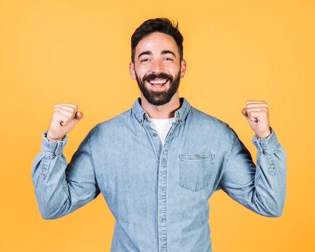 Medium shot guy expressing victory Free Photo