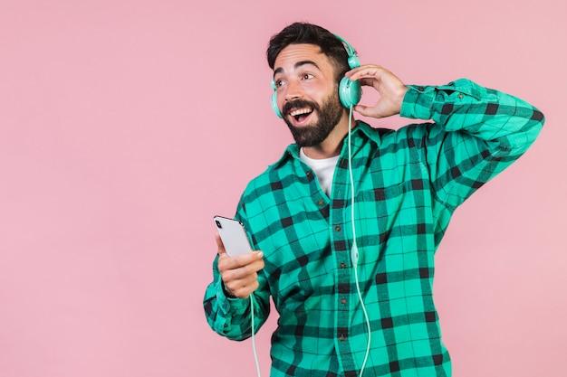 Medium shot guy listening to music Free Photo