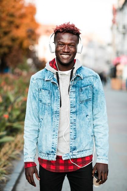 Medium shot guy posing with wide smile Free Photo