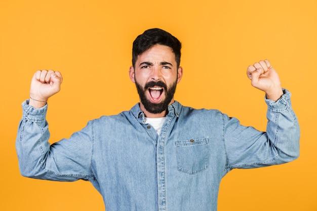 Medium shot guy showing excitement Free Photo