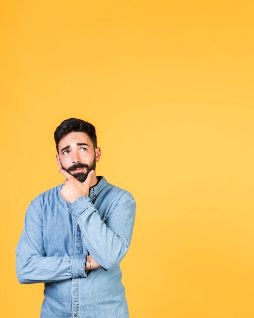 Medium shot guy thinking with copy space Premium Photo