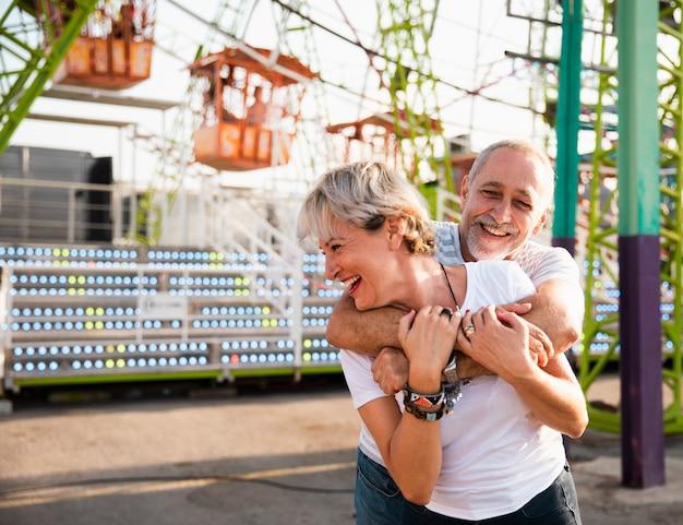 Medium shot happy adults having fun Free Photo